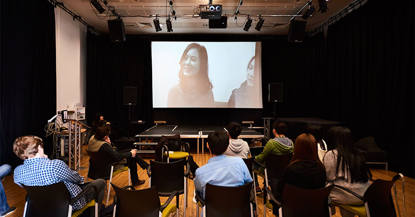 Students watching a film as part of their course