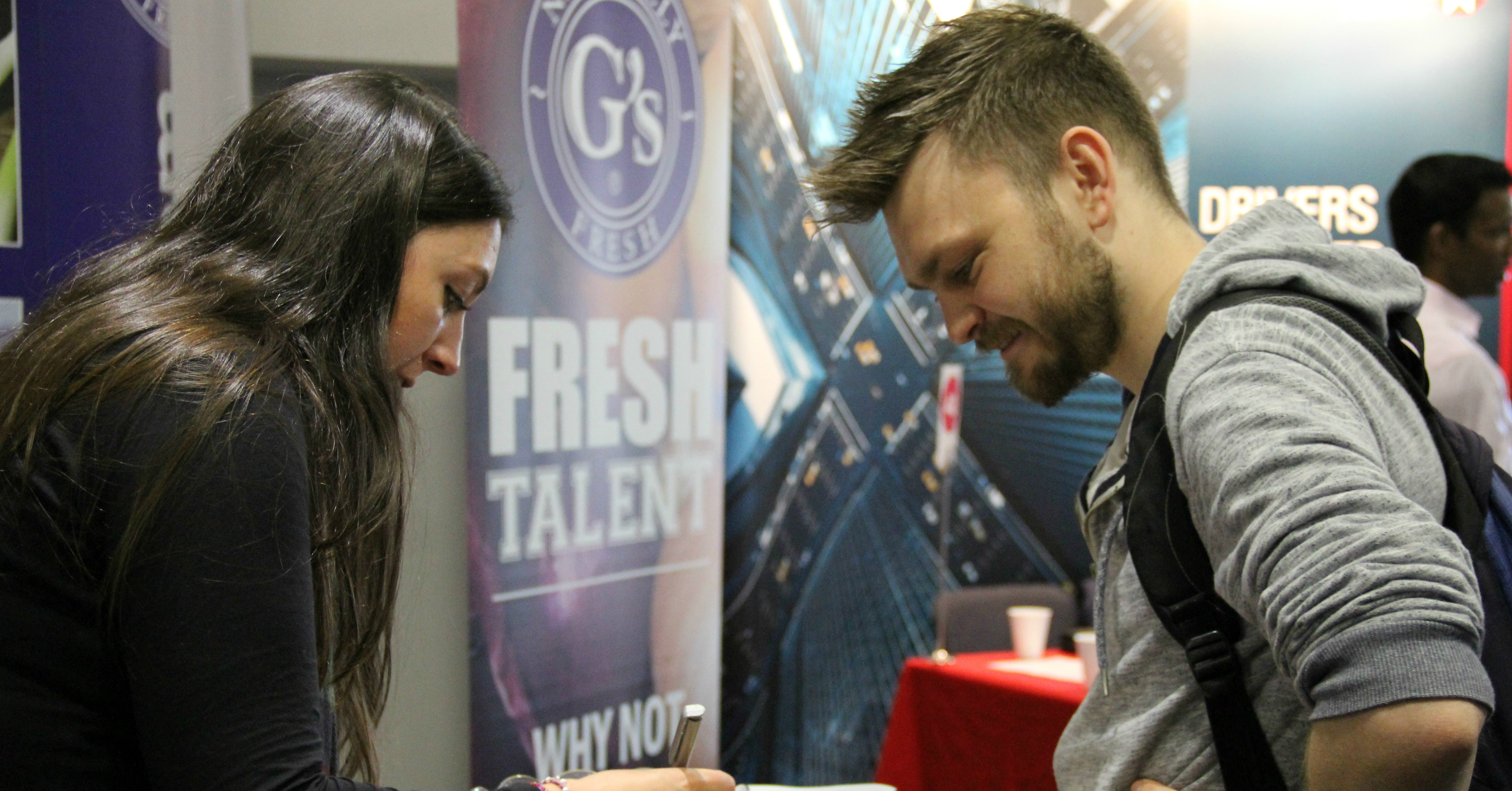 Student talking to employer at fair