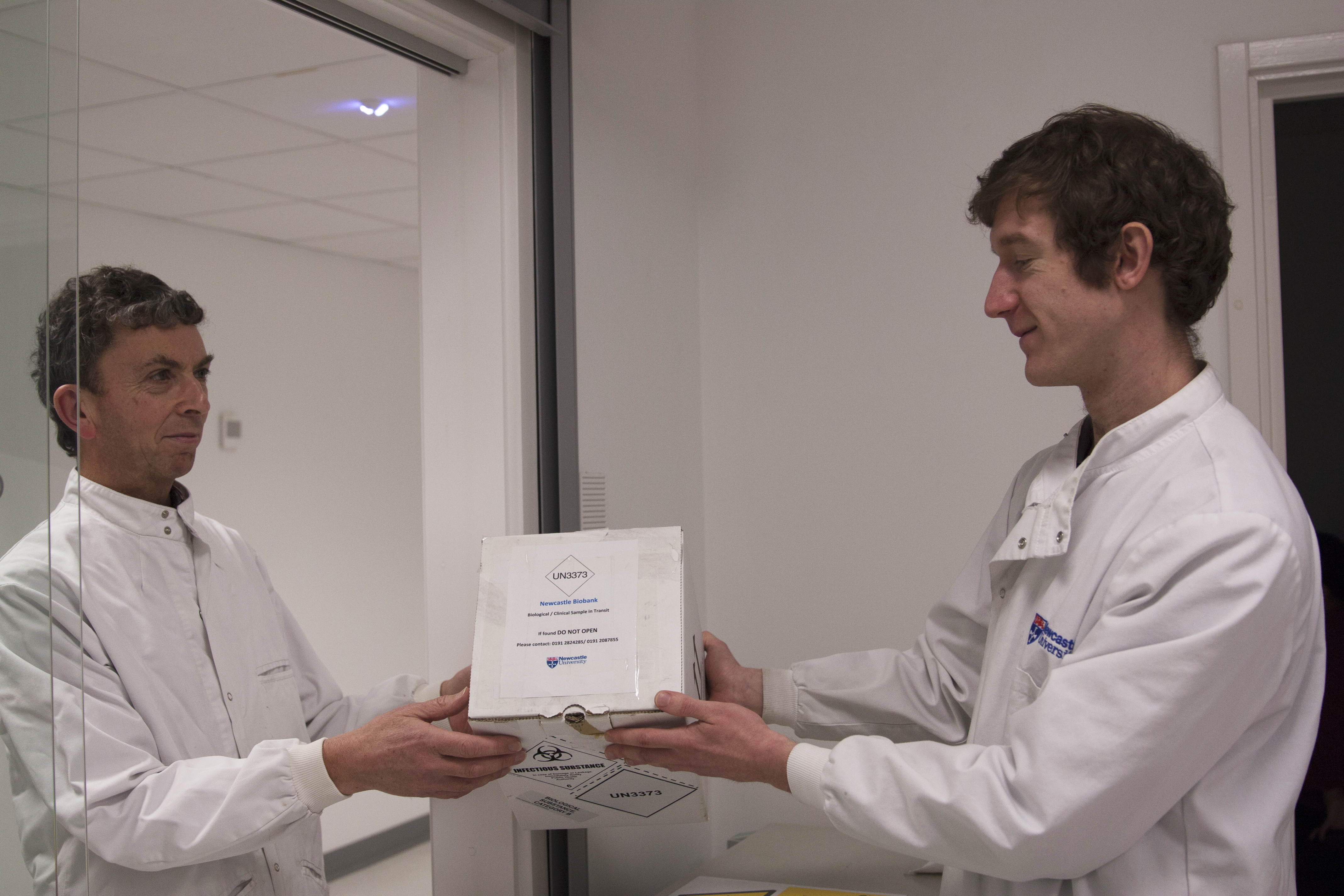 Samples being handed over to the Biobank