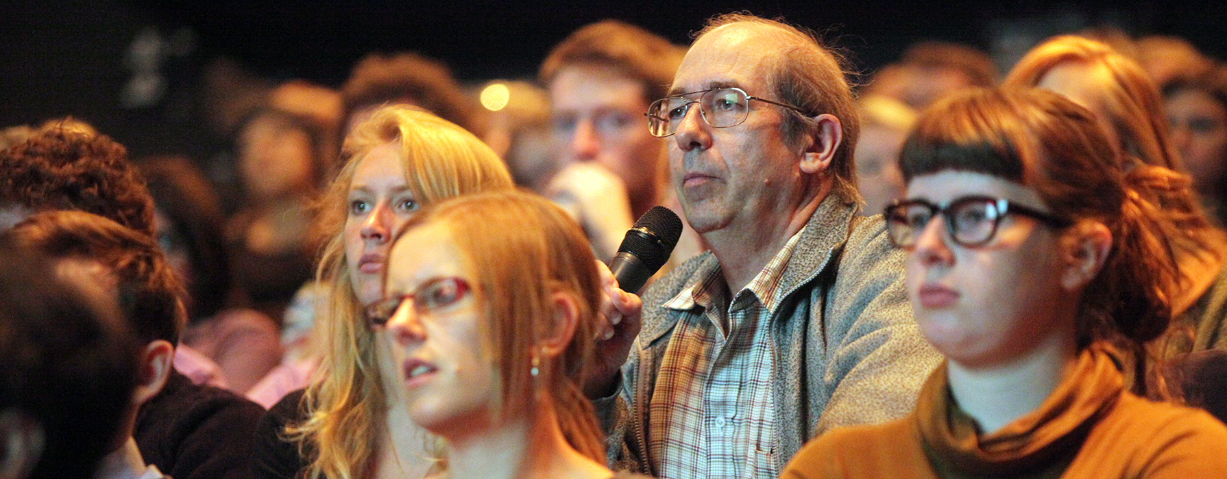 People in the audience at a public debate.