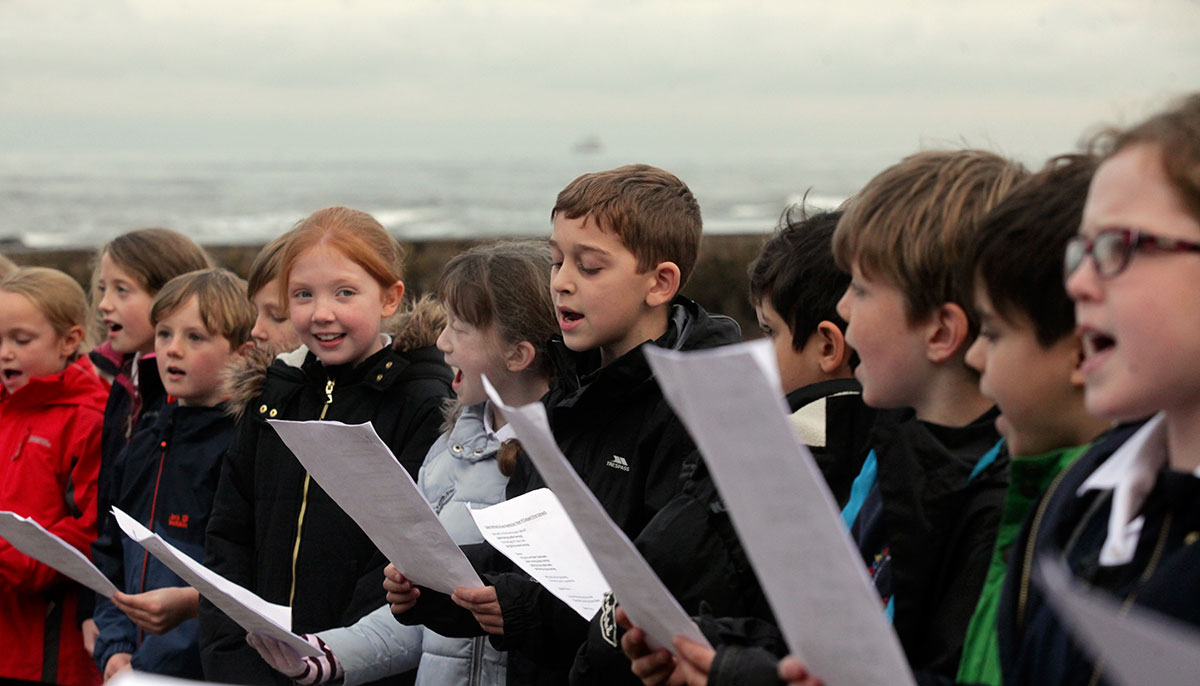 school children singing a sea shanty