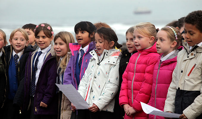 schoolchildren singing a sea shanty