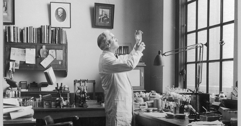 Sir Alexander Fleming in his lab