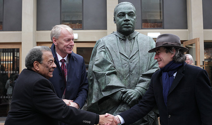 Andrew Young picture with the statue of Martin Luther King at Newcastle University