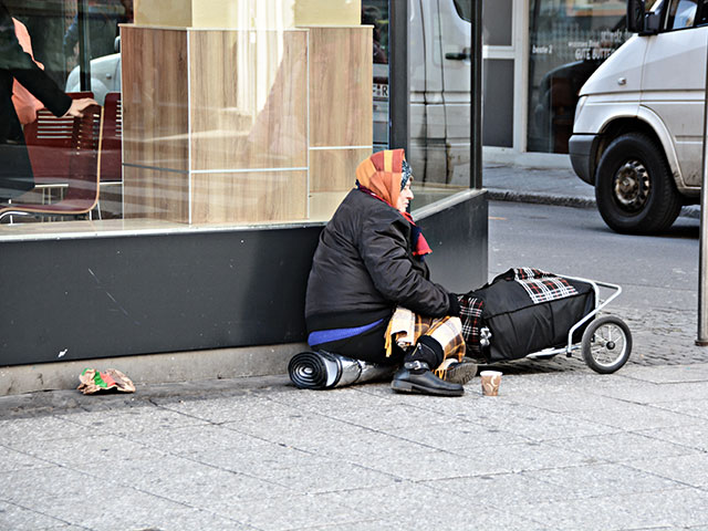 Article 22: Homeless woman on city street.