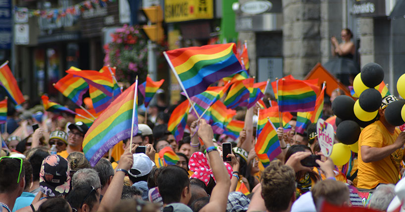 Pride march with rainbow flags