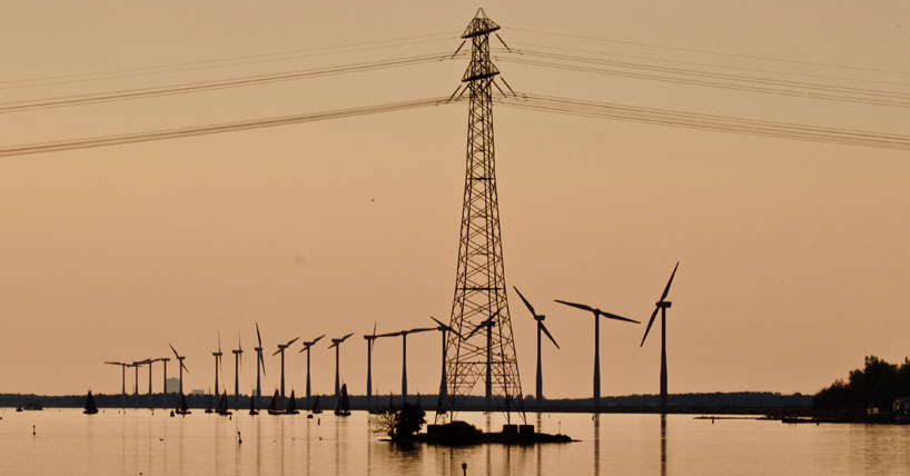 Wind turbines and pylon on river