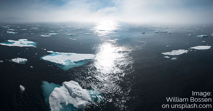 Climate conversation: melting ice on sea; William Bossen at unsplash.com