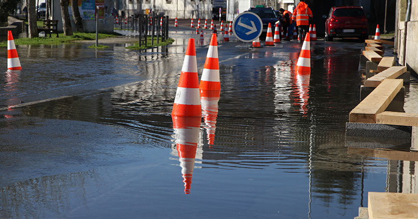 Flooded road with floating traffic cones