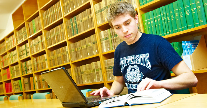 Postgraduate student studying in the Law library