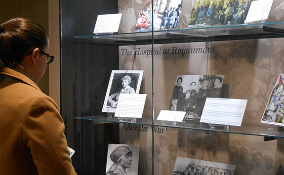 A woman looking through exhibition cabinets