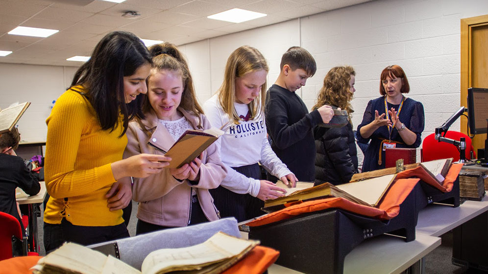 School children looking at Special Collections items