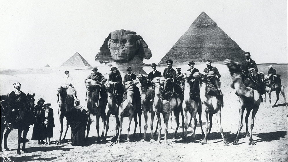 Photograph of Gertrude Bell and group on camels involved in the Cairo Conference
