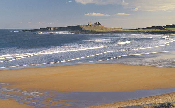 Dunstanburgh Castle overlooking the beach.