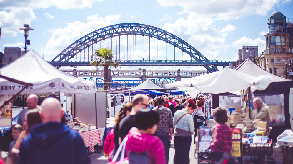 Shoppers look at market stalls at the weekly Quayside Market