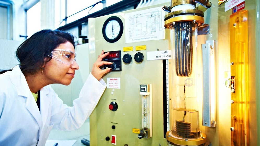 A student working with chemical engineering equipment