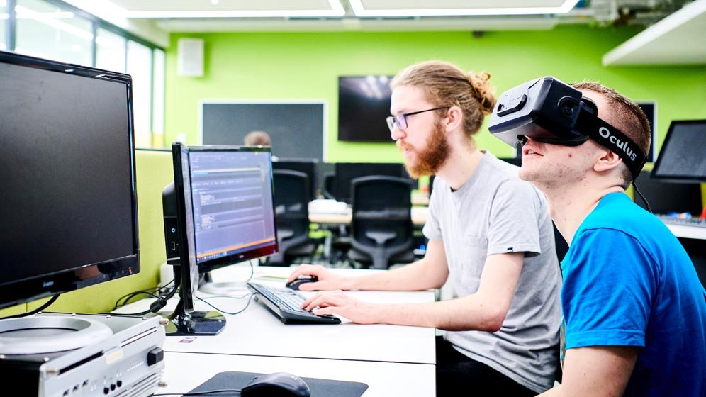 A student sits with a VR headset on