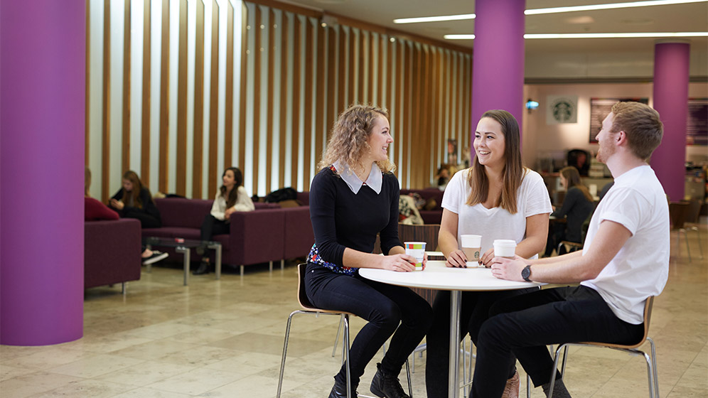 Students sat in the foyer of the Newcastle University Business School
