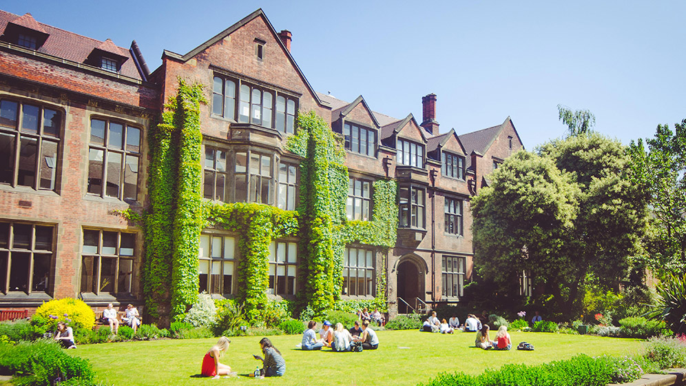 Students sitting in the Newcastle University Quadrangle