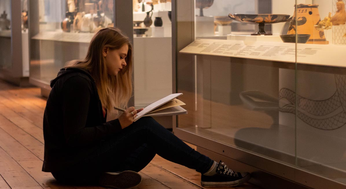 A student takes notes in the Great North Museum: Hancock