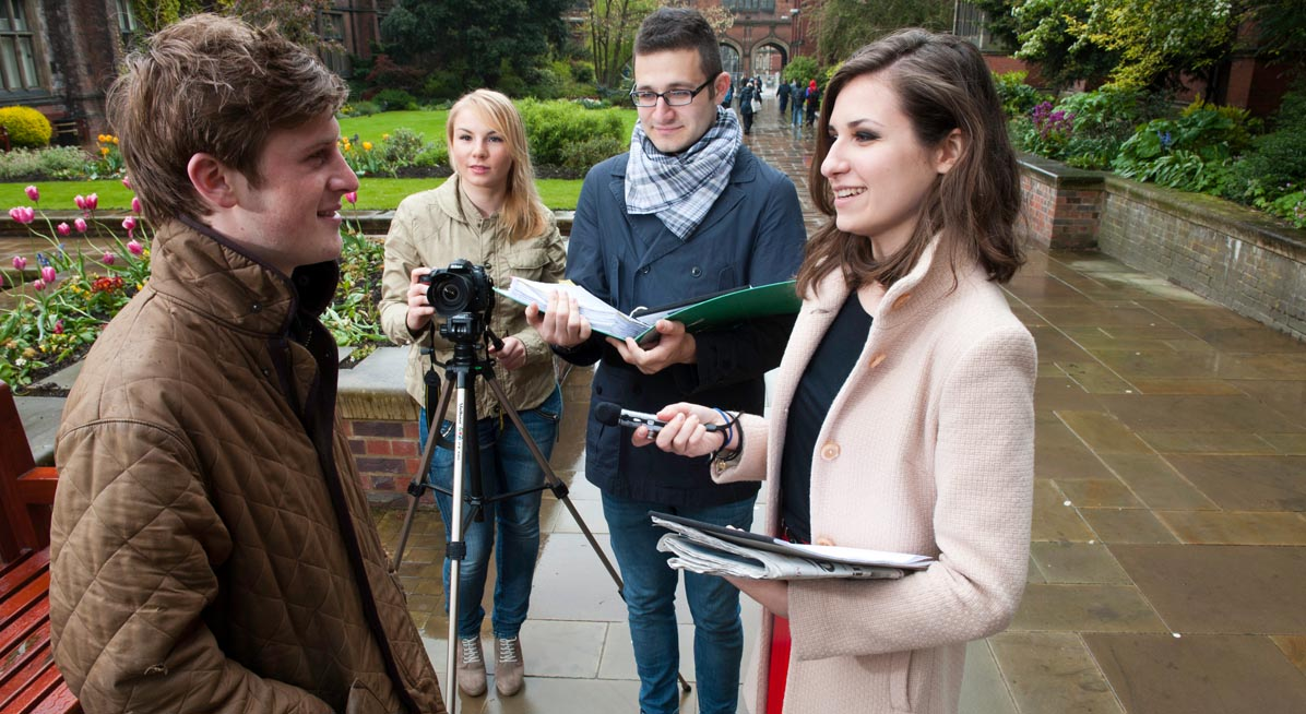 Students interviewing a man in the Old Quadrangle