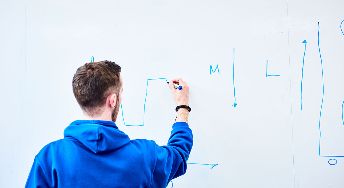 A student working on a whiteboard