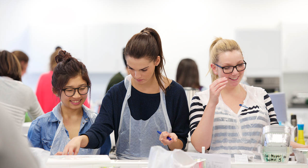 Students working in a food lab.